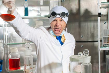 excultant emotional chemist in laboratory holding up flusk