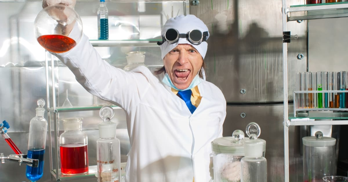 excultant emotional chemist in laboratory holding up flusk
